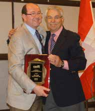 Dr. John O'Keefe (left), chairman of the OSAP association board from 2014 to 2016, is congratulated by Dr. Don Marianos, chairman of the OSAP Foundation board, at the 2016 Annual Conference.